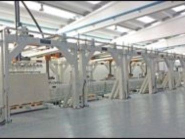 Studio 1 Automazioni Industriali propone nuove soluzioni High Tech per alimentazione, stoccaggio, applicazione stuoia, pre-scelta, movimentazione grandi formati